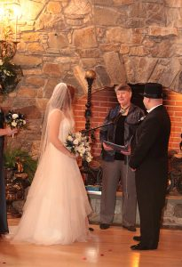 Beth Koehler officiating a wedding with bride and groom